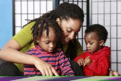 teacher teaching 2 child