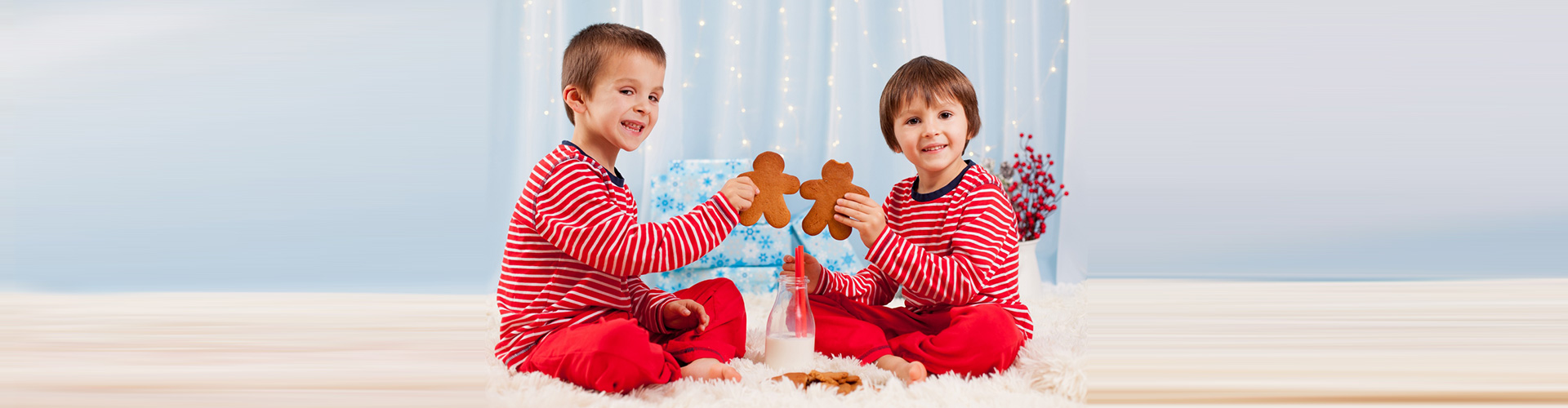two boys holding gingerbread man